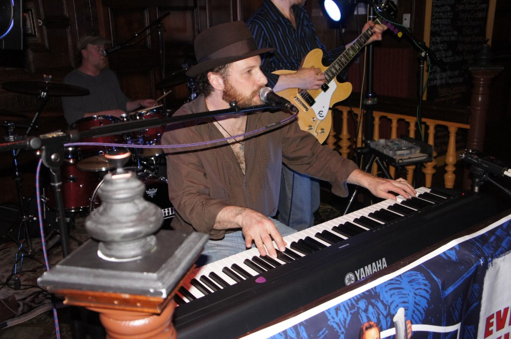 Craig Herlihy performing live on keyboards with rock band Yoke Shire